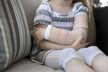 Child With Cast After Medical Negligence